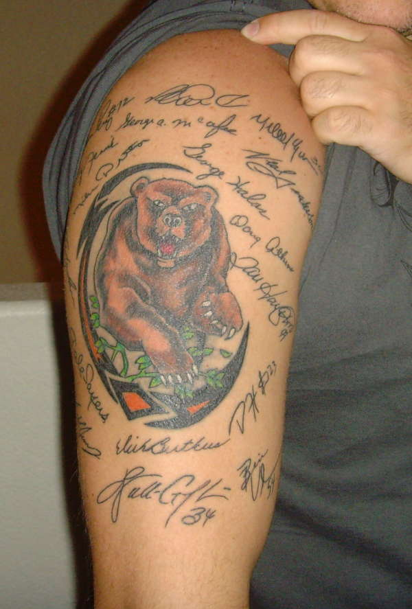 Brown Bear And Tribal Muscles Tattoos