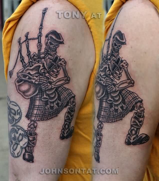 Brown Ink Bagpiping Skeleton Tattoo On Biceps