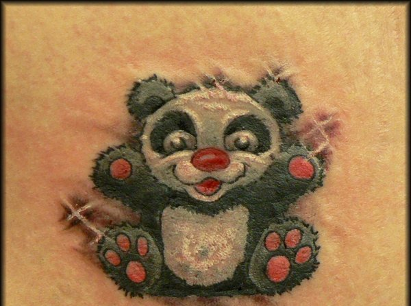 Cheerful Panda With Red Nose Tattoo