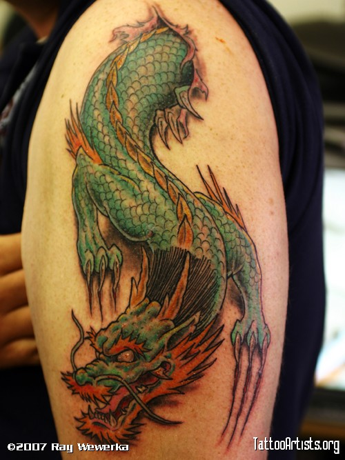 Chinese Dragon Ripped Skin Tattoo On Upper Arm