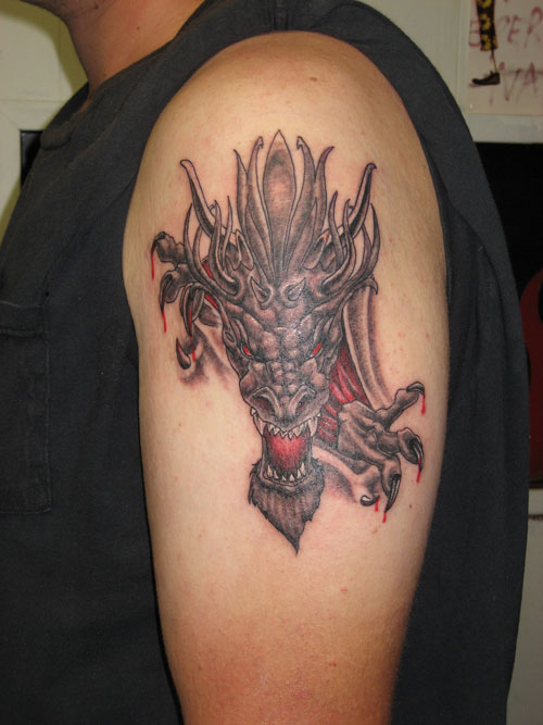 Chinese Dragon Ripping Through Skin Tattoo On Biceps