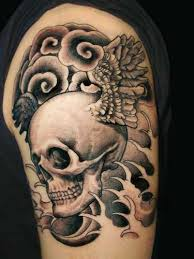 Clouds Skull And Waves Tattoos On Biceps
