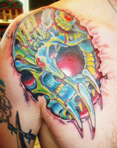 Colorful Biomechanical Skull Ripped Skin Tattoo