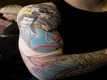 Colorful Dressed Japanese Girl Tattoo On Muscles