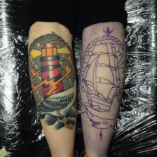 Colorful Lighthouse And Ship Outline Tattoos On Leg