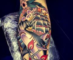Colorful Ship Whale And Anchor Tattoos On Arm