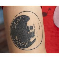 Cool Dead Skull And Crescent Moon Tattoo