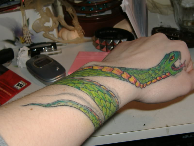 Cool Green Snake Snake Around Wrist Tattoo