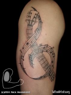 Cool Music Tattoo On Muscles