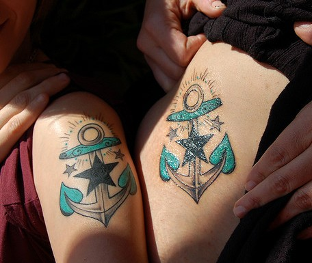 Couple Anchors Tattoo On Arm And Thigh