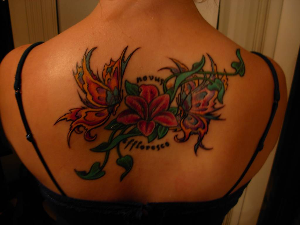 Couple Of Butterflies And Orchid Tattoos On Upperback