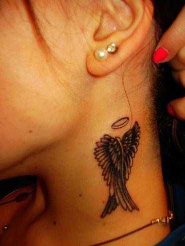 Crossed Wings Neck Tattoos