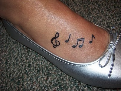 Cute Black Music Note Tattoos On Foot