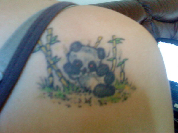 Cute Panda In Forest Tattoo On Shoulder Blade