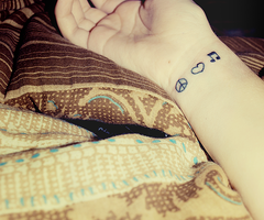 Cute Peace Love And Music Sign Tattoos On Inner Wrist