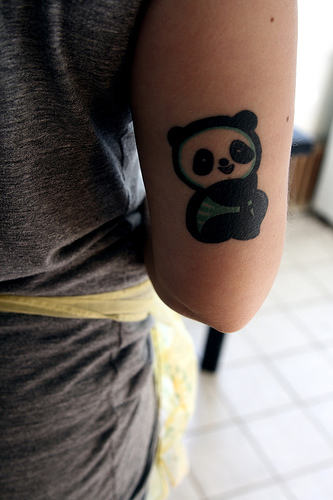 Cute Smile Panda Tattoo On Back Arm
