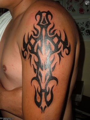 Dark Black Ink Tribal Cross Muscles Tattoo