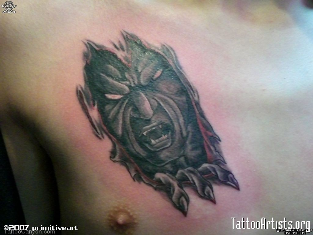 Dark Black Ink Wicked Ripped Skin Tattoo On Chest