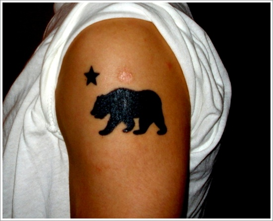 Dark Black Star And Walking Panda Bear Tattoos On Shoulder