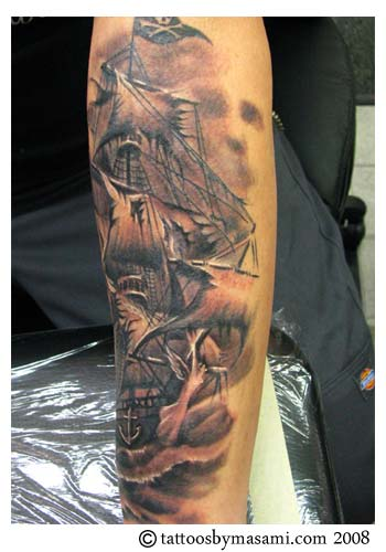 Dark Grey Ink Ocean Pirate Ship Tattoo