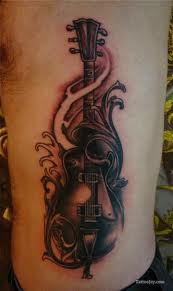Dark Guitar And Waves Tattoo On Rib Side