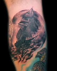 Dark Sea Ship And Eagle Tattoos