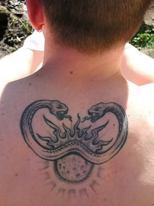 Double Headed Snake And Tribal Sun Tattoos On Upperback