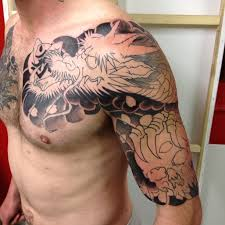 Dragon Chest And Half Sleeve Tattoo For Men
