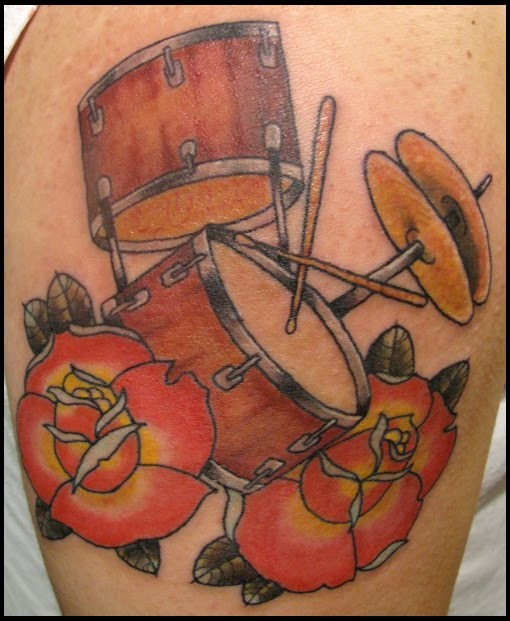 Drum Kit And Couple Of Rose Tattoos