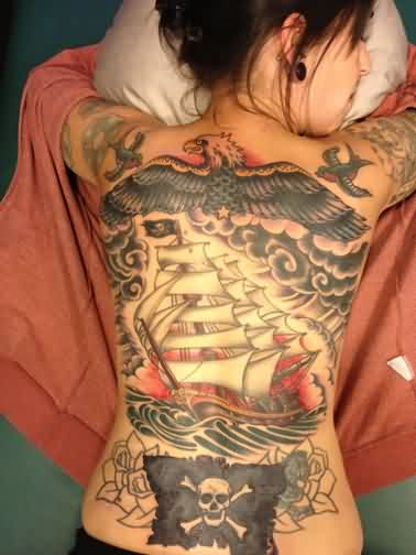 Eagle Ship And Pirate Flag Tattoos On Back