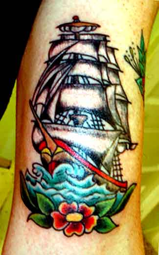 Enchanting Ship With A Red Flower Tattoo