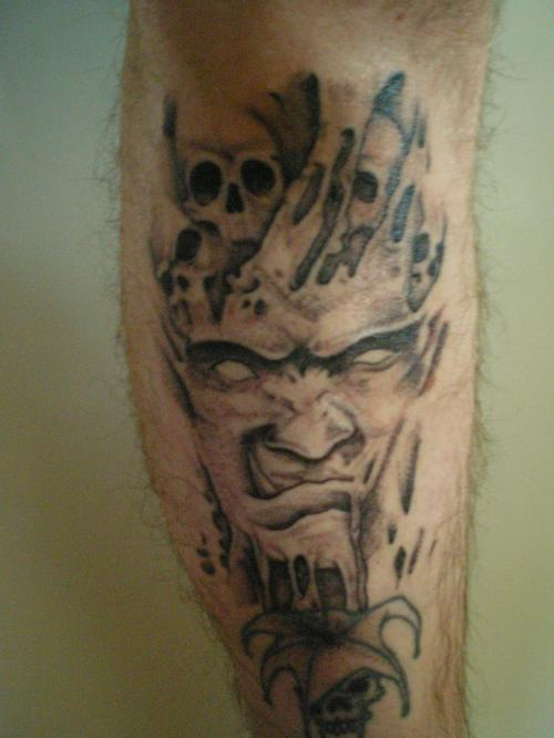 Evil Monster Face Tattoo