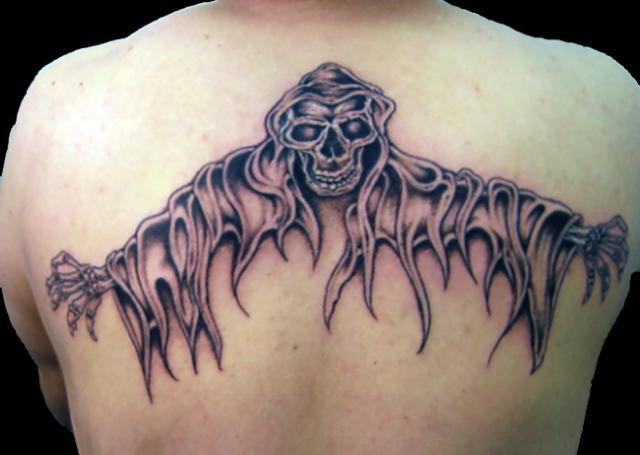Evil Skeleton Tattoo On Upperback For Men