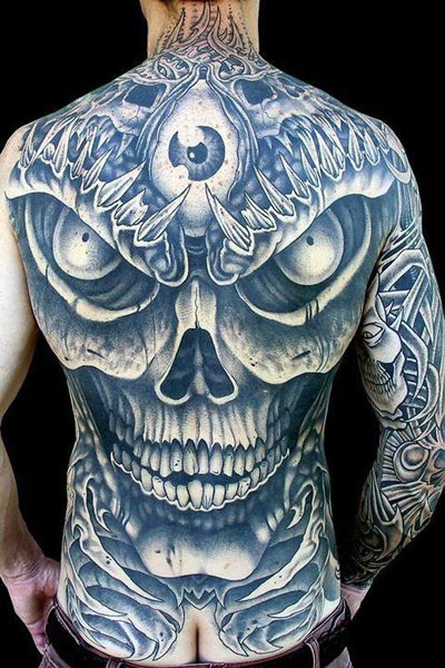 Eye And Black Skull Tattoos On Whole Back