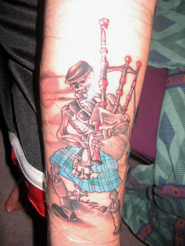 Fabulous Bagpiping Skeleton Tattoo On Lower Arm