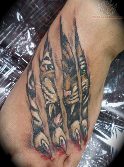 Fabulous Tiger Claw Ripped Skin Tattoo On Foot