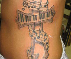 Fantastic Music Notes Cross Tattoo On Rib Side