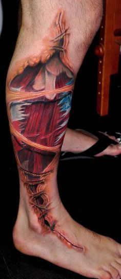 Fantastic Torn Ripped Skin Muscles Tattoo On Leg