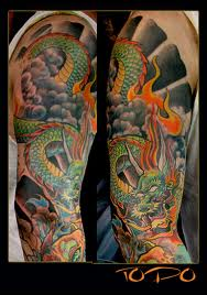 Flames And Dragon Sleeve Tattoos