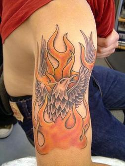 Flames And Eagle Tattoos On Muscles