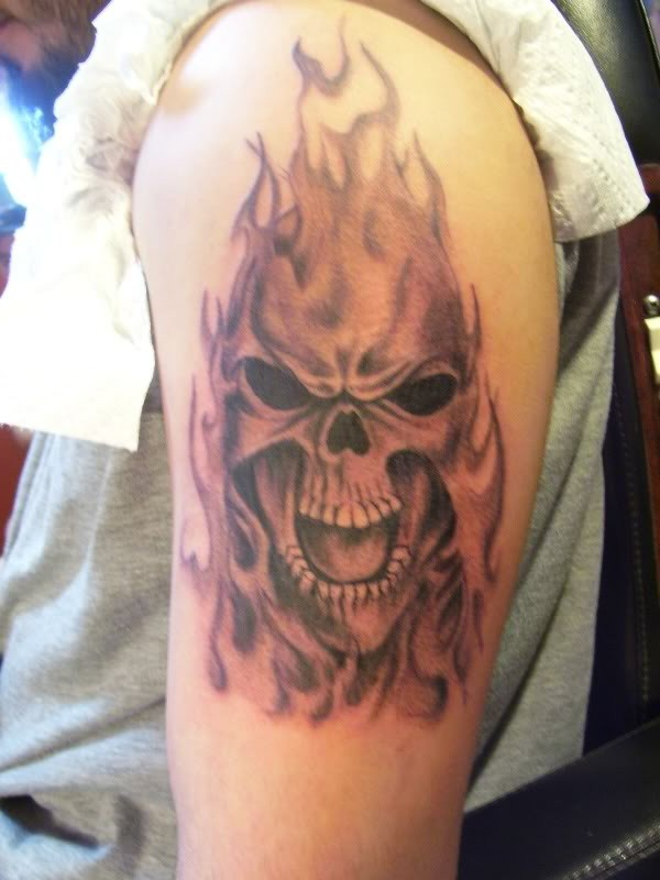 Flames From Screaming Skull Tattoo On Biceps