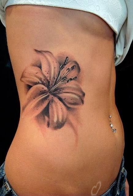 Flower Tattoo On Side Of Stomach