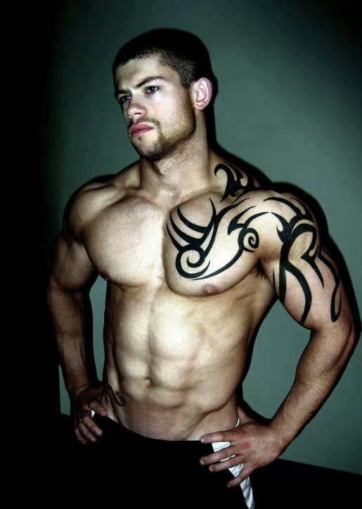 Fresh Tribal Chest And Muscles Tattoo