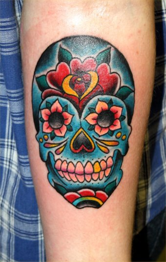 Gorgeous Blue Sugar Skull Tattoo On Arm