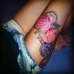 Gorgeous Colored Roses Tattoos On Thigh