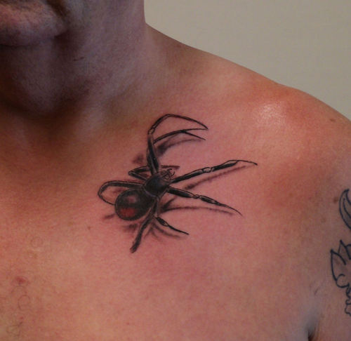 Great Black Spider Tattoo On Collarbone