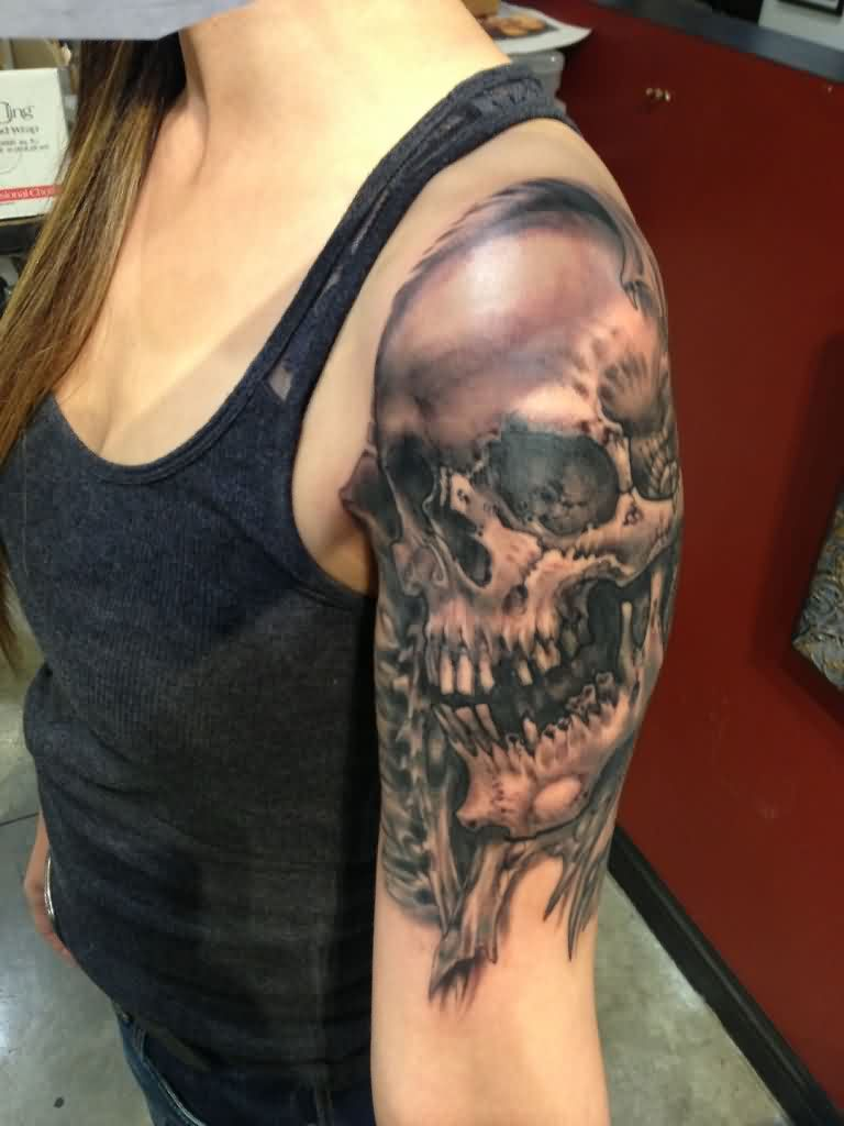 Grey Ink Dead Skull Tattoo On Shoulder