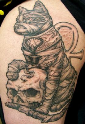 Grey Ink Egyptian Cat With Skull Tattoo