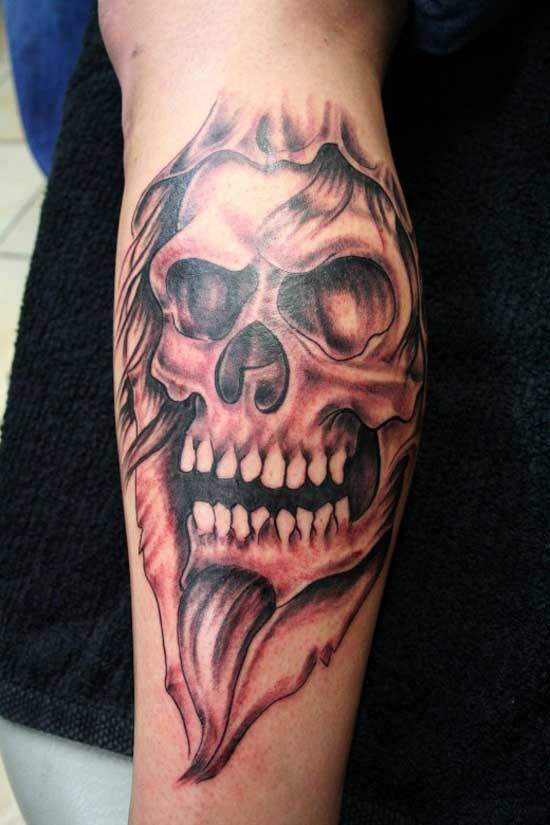 Grey Ink Evil Skull Tattoo On Arm