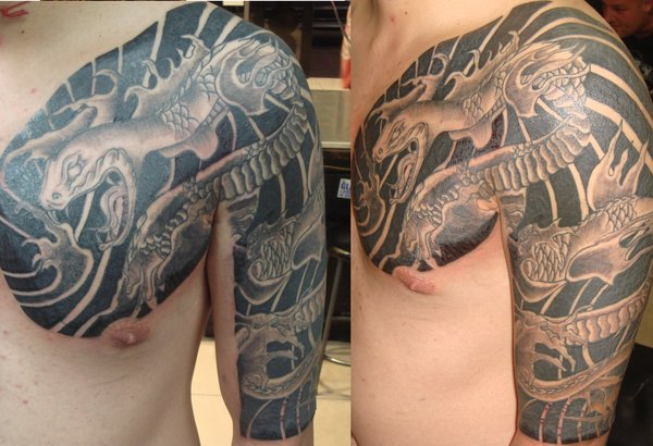 Grey Ink Japanese Snake Tattoo On Chest